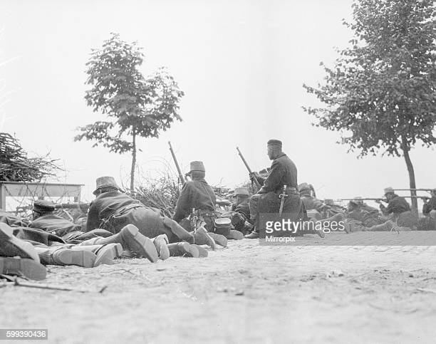 Belgian riflemen lying on the road facing the German advance at Louvain The barricade was made from brushwood and tables and hurriedly assembled...
