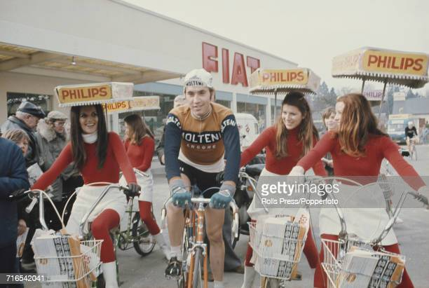 Belgian road race cyclist Eddy Merckx pictured with young women on bicycles promoting the Dutch company Philips at a cycling race event in 1971 Eddy...
