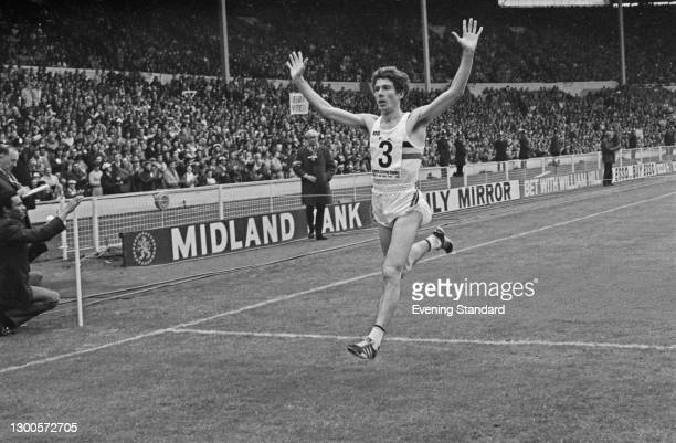 Belgian runner Emiel Puttemans wins the 3000 metre race at Wembley Stadium in London, before the FA Cup Final between Leeds United and Sunderland,...