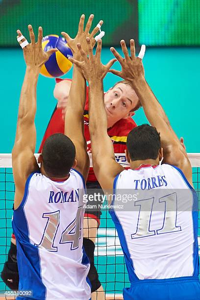 Belgian Sam Deroo attacks during the FIVB World Championships match between Belgium and Puerto Rico at Cracow Arena on September 2, 2014 in Cracow,...