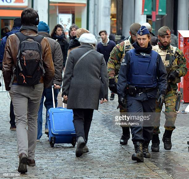 Belgian security forces patrol on the streets as the Belgian authorities raised the terror alert to the level 4 highest level warning of an 'imminent...