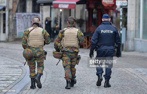 Belgian security forces patrol on the streets as the Belgian authorities raised the terror alert to the level 4, highest level warning of an...
