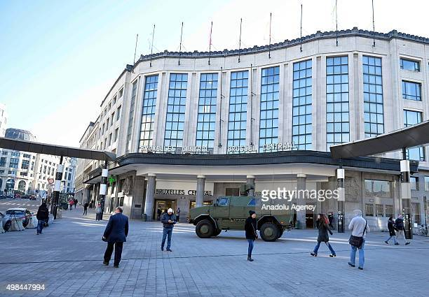 Belgian security forces with armored vehicles patrol in streets in Brussels where all stores had to close following the terror alert level being...