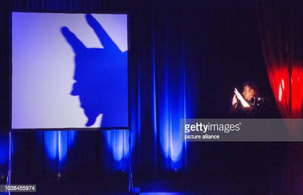 Belgian shadow puppeteer Hans Davis performs on stage during a dress rehearsal for the 'Hamburgs Perle' show at the Hansa Variete Theater in Hamburg...