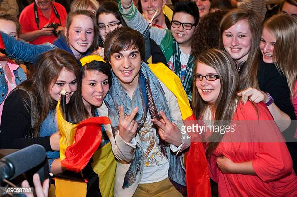 Belgian singer and 2013 Eurovision contestant Roberto Bellarosa poses with his fans as the arrives at Brussels National Airport on May 19, 2013 in...