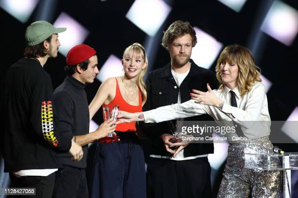 Belgian singer Angele and her brother Belgian rapper Romeo Elvis celebrate on stage after receiving the the best audiovisual creation award during...