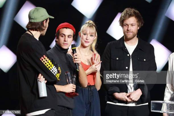 Belgian singer Angele and her brother Belgian rapper Romeo Elvis celebrate on stage after receiving the best audiovisual creation award during the...
