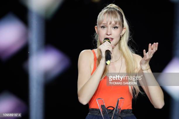 Belgian singer Angele celebrates as she receives the best revelation album award during the 34th Victoires de la Musique the annual French music...