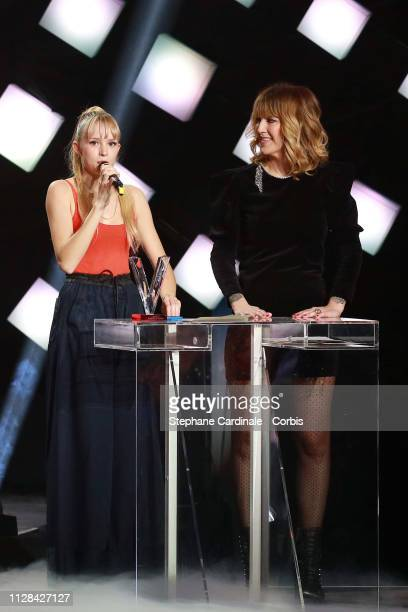 Belgian singer Angele celebrates on stage after receiving the best audiovisual creation award during the 34th 'Les Victoires De La Musique' Show at...
