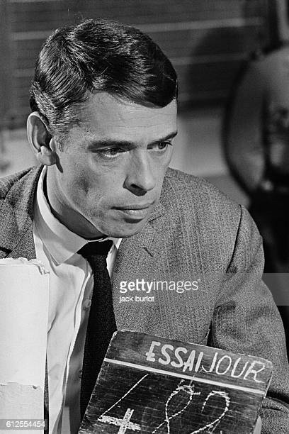 Belgian singer Jacques Brel on the set of the film Les Risques du Metier directed by Andre Cayatte