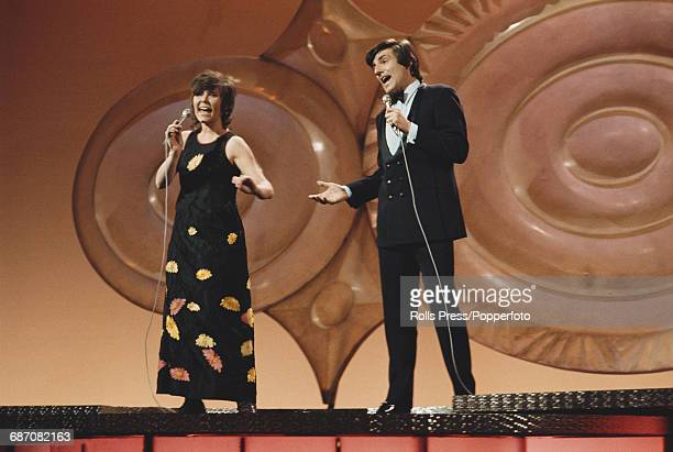 Belgian singers Lily Castel and Jacques Raymond perform the song 'Goeiemorgen morgen' on stage for Belgium in the 1971 Eurovision Song Contest at the...