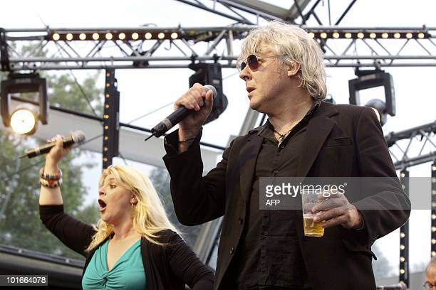 Belgian singers Sandra Kim and Arno sing J'aime la vie on the stage of the second Belgavox concert on June 6 2010 in front of the Paleizenplein in...