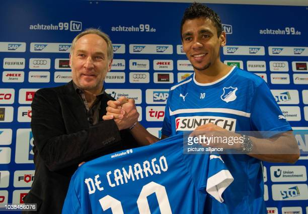 Belgian soccer player Igor de Camargo and Hoffenheim's manager Andreas Mueller hold Camargo's new shirt as he is presented at the German Bundesliga...