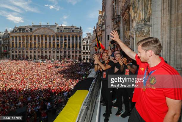 Belgian soccer team coach Roberto Martinez and Belgian soccer team player Jan Vertonghen celebrate on the balcony of the city hall at the Brussels'...