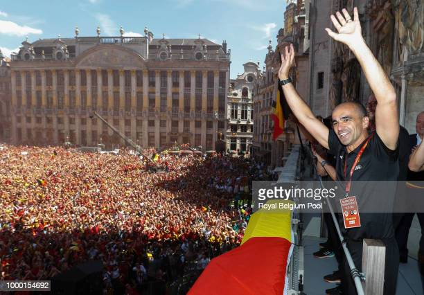 Belgian soccer team coach Roberto Martinez celebrates on the balcony of the city hall at the Brussels' Grand Place, after taking the third place in...