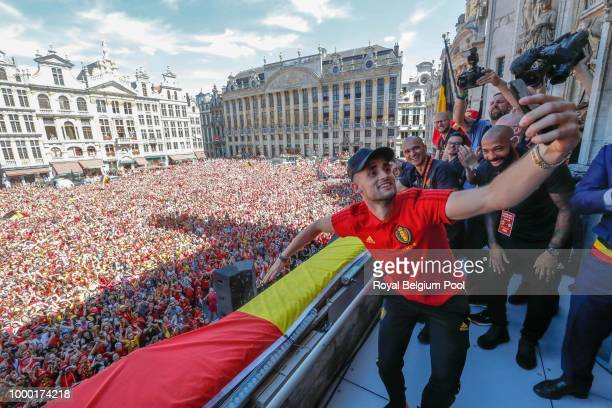 Belgian soccer team player Adnan Januzaj takes a selfie as he celebrates on the balcony of the city hall at the Brussels' Grand Place after taking...