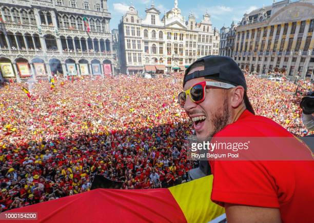 Belgian soccer team player Eden Hazard celebrates on the balcony of the city hall at the Brussels' Grand Place, after taking the third place in the...
