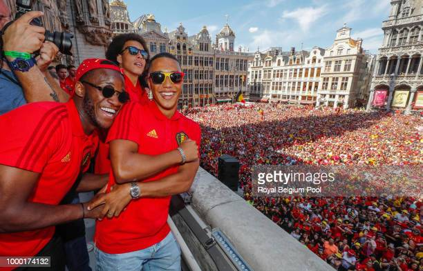 Belgian soccer team player Michi Batshuayi celebrate on the balcony of the city hall at the Brussels' Grand Place after taking the third place in the...