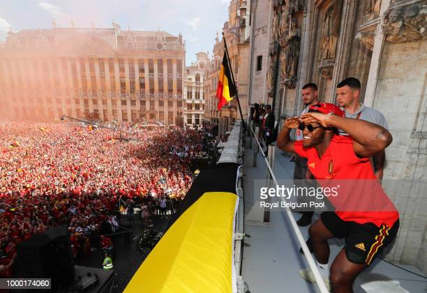 Belgian soccer team player Michi Batshuayi celebrates on the balcony of the city hall at the Brussels' Grand Place after taking the third place in...