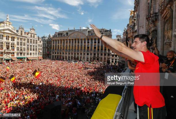 Belgian soccer team player Thibaut Courtois celebrate on the balcony of the city hall at the Brussels' Grand Place after taking the third place in...