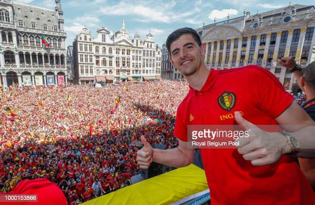 Belgian soccer team player Thibaut Courtois celebrates on the balcony of the city hall at the Brussels' Grand Place after taking the third place in...