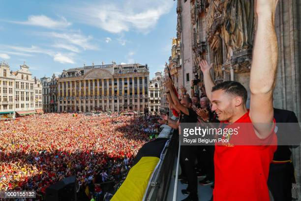 Belgian soccer team player Thomas Vermaelen celebrates on the balcony of the city hall at the Brussels' Grand Place after taking the third place in...