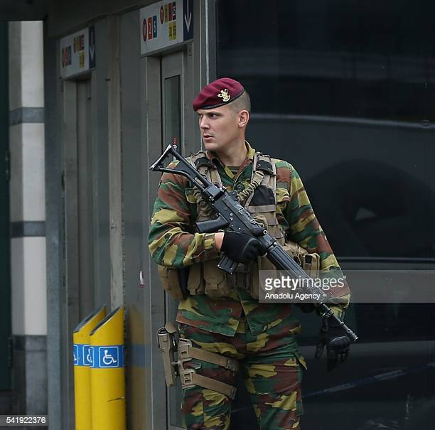 Belgian soldier keeps guard as stores were closed due to a phone call reporting a bomb threat at a shopping center area in Brussels Belgium on June...