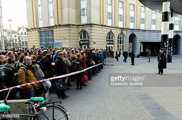 Belgian soldiers and police stand at a cordon set to limit the number of people allowed into the central Station in Brussels on March 22 2016...