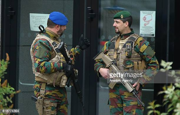 Belgian soldiers are seen standing guard after the previous several terrorist attacks in Brussels Belgium on October 28 2016 It is decided to...