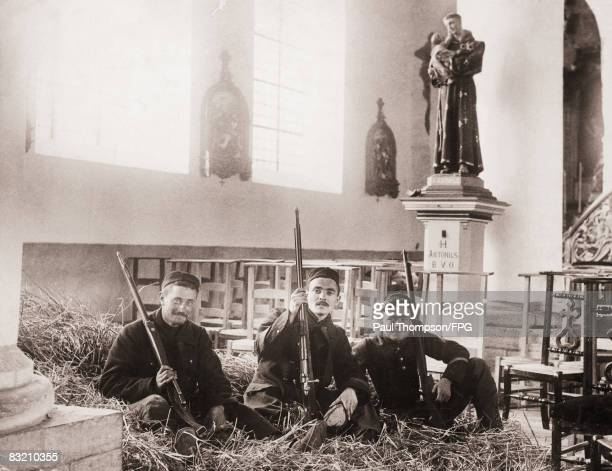 Belgian soldiers billeted in the old church of Cumptick, near Louvain, during World War I, circa 1914.