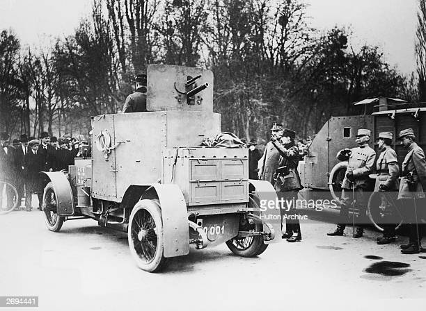 Belgian soldiers driving an armoured 1911 Silver Ghost by Rolls Royce and a Mors command car during World War I
