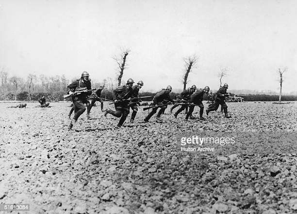 Belgian soldiers make a charge near the River Yser during World War I, circa 1914.