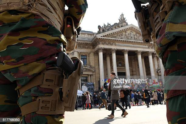 Belgian soldiers patrol Place de la Bourse on March 27 in Brussels Belgium Days after suicide bomber attacks at Brussels Zaventem airport and...
