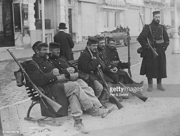 Belgian Soldiers Resting on Bench France