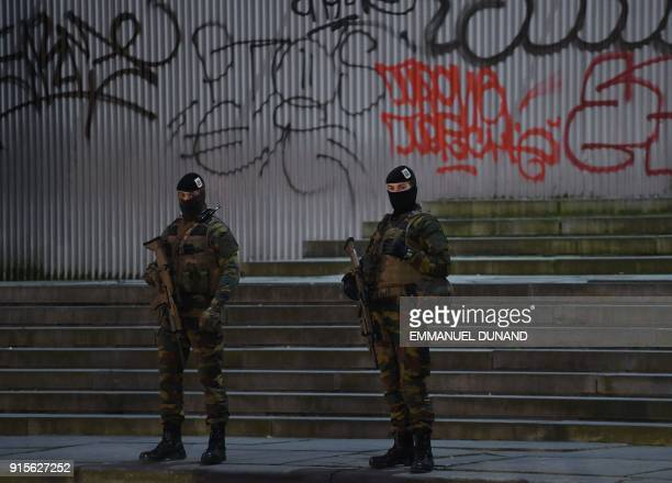 Belgian soldiers stand guard at the entrance to the Palais de Justice courthouse in Brussels on February 8 2018 for the second day of the trial of...