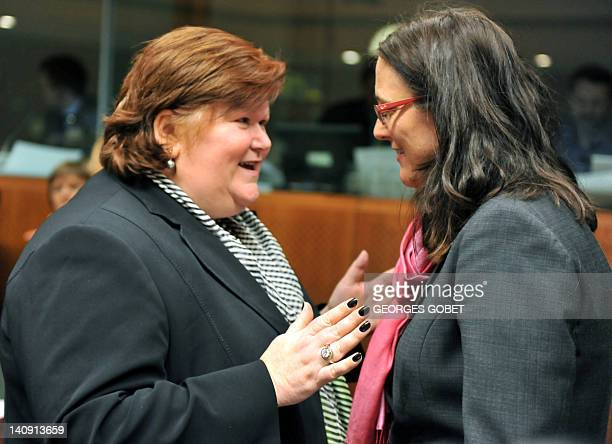 Belgian State Secretary for Asylium and Immigration Maggie De Block and EU commissioner for Home Affairs Cecilia Malmstrom talk prior to a Justice...