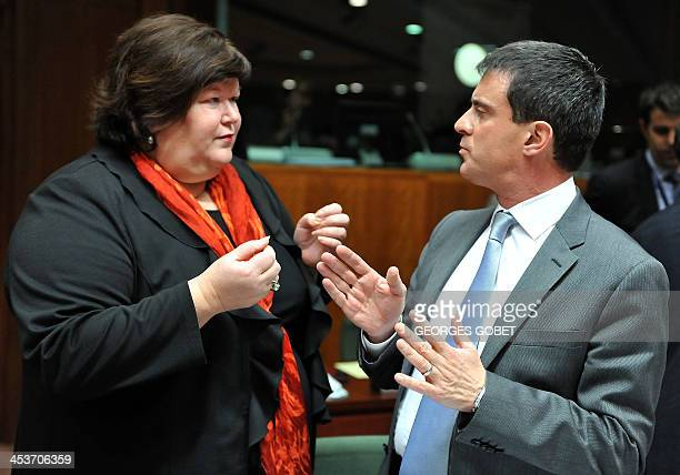 Belgian State Secretary for Home Affairs Maggie De Block speaks with French Interior minister Manuel Valls prior to a Justice and Home Affairs...