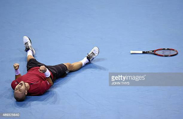 Belgian Steve Darcis reacts after winning the Davis cup semi-final against Argentinian Federico Delbonis at the Forest National Arena on September...