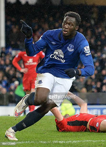 Belgian striker Romelu Lukaku celebrates scoring his team's second goal during the English Premier League football match between Everton and...