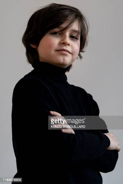 Belgian student Laurent Simons 9 years old poses during a photo session at his home on November 21 2019 in Amsterdam Laurent Simons is studying...