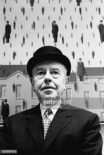 Belgian Surrealist painter Rene Magritte photographed at the Museum of Modern Art in New York City