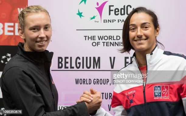 Belgian tennis player Alison Van Uytvanck and French Caroline Garcia pose for photographers after the draw of the playing schedule for this weekend's...