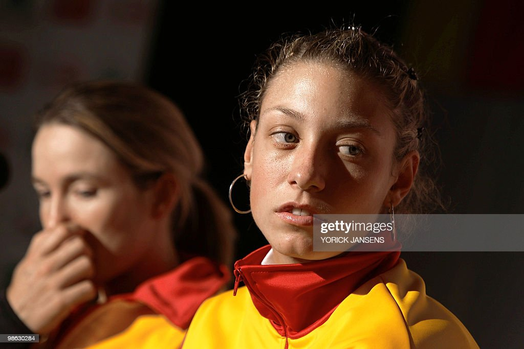 Belgian tennis player Justine Henin (L) and teammate Yanina Wickmayer are pictured during a press conference after the drawing for the Fed Cup meeting Belgium vs Estonia, on April 23, 2010, in Hasselt. Henin has a broken finger and will only play the doubles game.