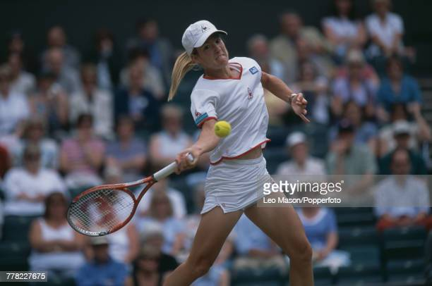 Belgian tennis player Justine Henin pictured in action during progress to reach the final of the Ladies' Singles tournament at the Wimbledon Lawn...