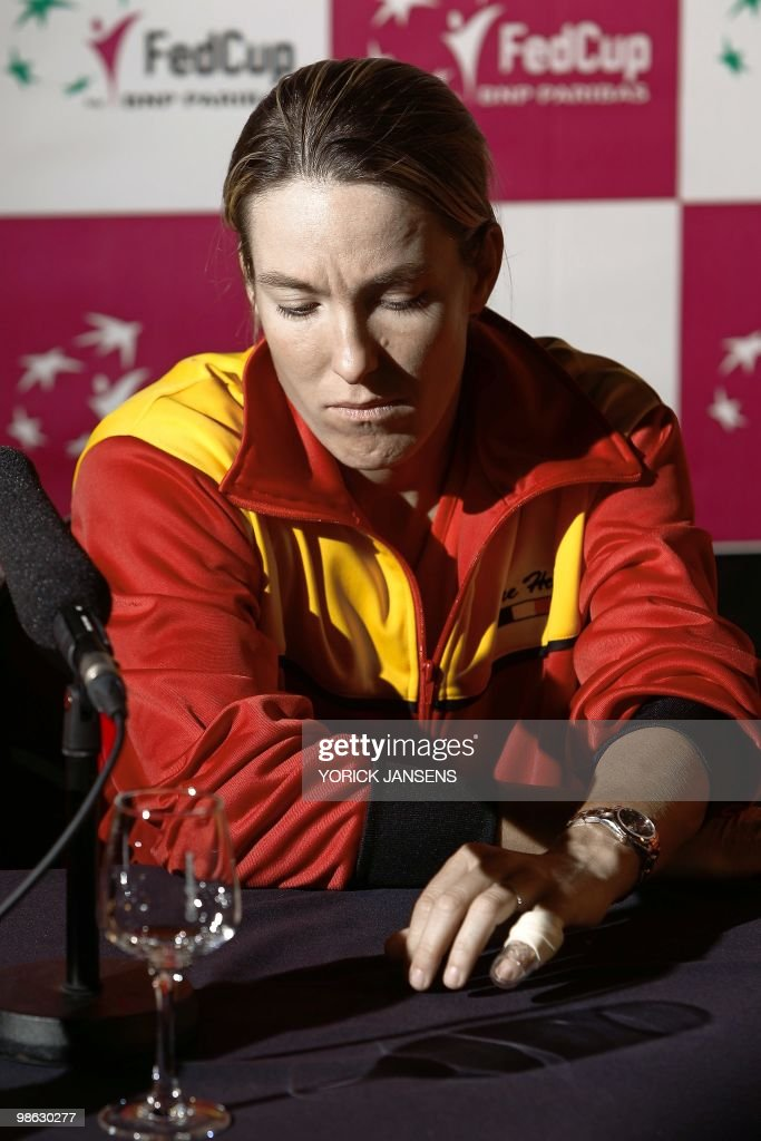 Belgian tennis player Justine Henin, with a broken finger, sits during a press conference after the draw for the Fed Cup meeting Belgium vs Estonia, on April 23, 2010, in Hasselt.