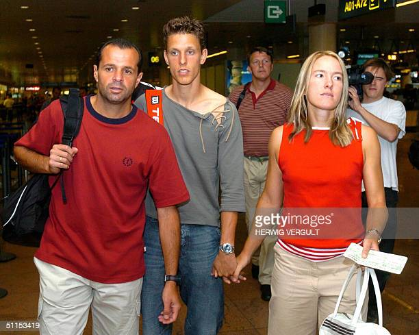 Belgian tennis player Justine HeninHardenne her husband PierreYves and coach Carlos Rodriguez are seen prior to her flight to Athens to attend the...