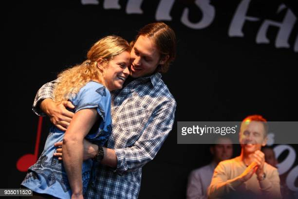 Belgian tennis player Kim Clijsters and her husband Brian Lynch celebrate on September 18 2009 in Bree Clijsters won this year's edition of the US...