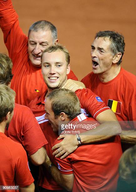Belgian tennis player Steve Darcis celebrates with Olivier Rochus and the rest of the team as he won 6-2, 6-1, 6-0 his match against Ukrainian Sergiy...