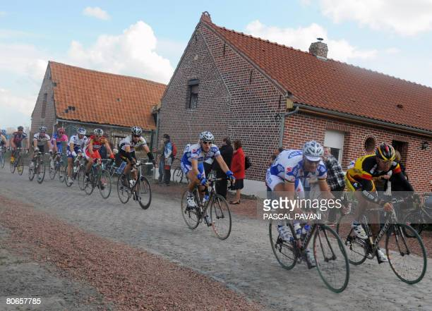 Belgian Tom Boonen and Belgian Stijn Devolder ride on April 13 2008 on the cobblestone section during the 106th ParisRoubaix cycling race between...