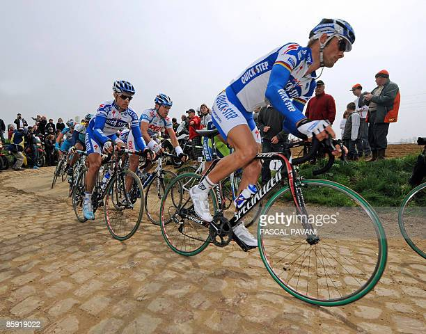 Belgian Tom Boonen and French Sylvain Chavanel ride on a cobblestone section during the 107th edition of the ParisRoubaix cycling race between...